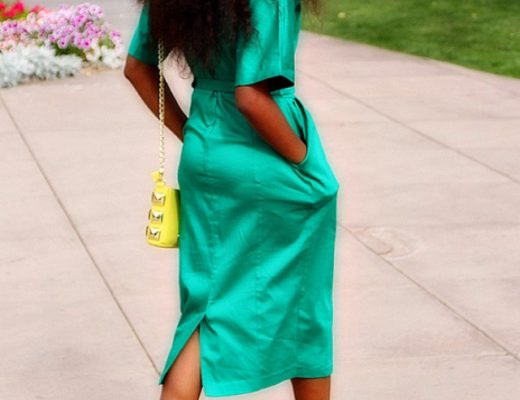 Green midi dress with back slit paired with block heels