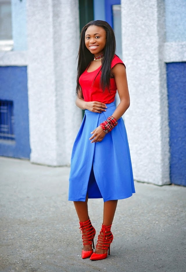 Fashion blogger styling a lace up pumps and wrap skirt