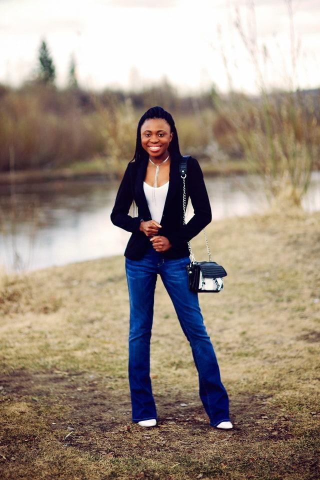 Flared denim jeans, fitted blazer, zebra purse, bodysuit, platform wedge, Wyoming blogger