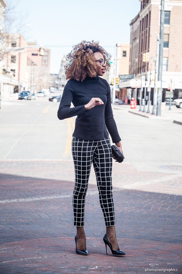 A candid shot in a black stripe summer outfit: ankle pants, lace up top and faux leather heels