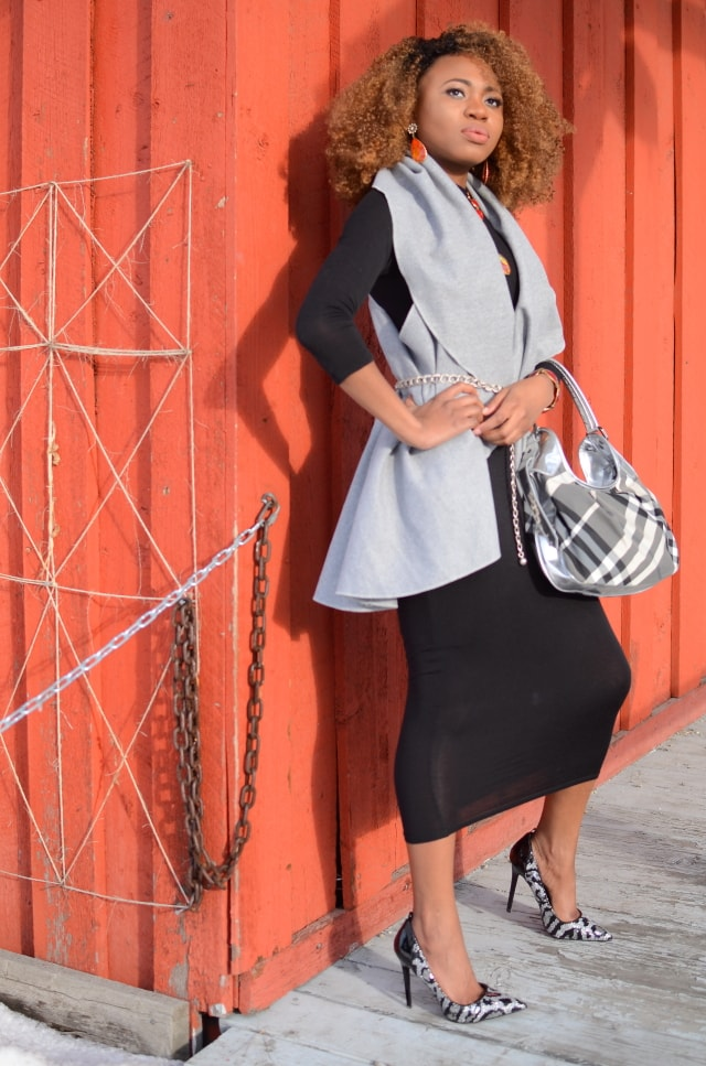Rocking a turtleneck midi three-quarter sleeve bodycon dress