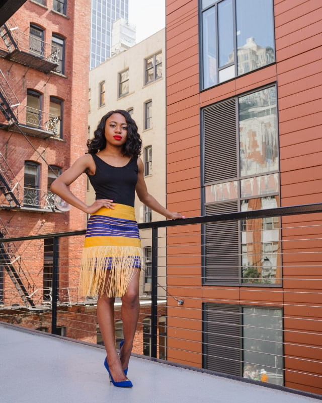 Aso oke fringe skirt: Keeping it simple and chic with a custom-made Nigerian aso oke fringe skirt paired with an open back sleeveless bodysuit. Visit the blog to for more.