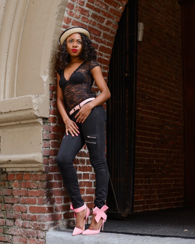 Happily Black with a touch of Pantone's 2016 color, Rose Quartz. Stun others in this backless lace bodysuit, paired with black skinny jeans, a pair of trendy bow pumps and embellished bow belt. Topped up with a straw bowler hat and popping red lipstick. Chic is an understatement. Click for more!