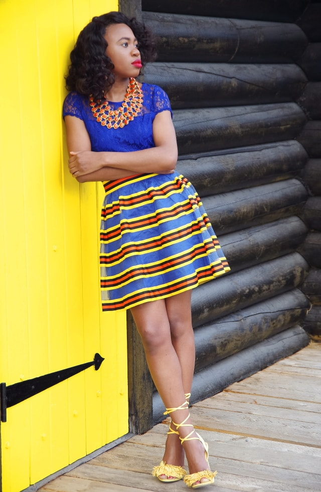 Colorful skirt paired with a fun fringe tie-up sandals