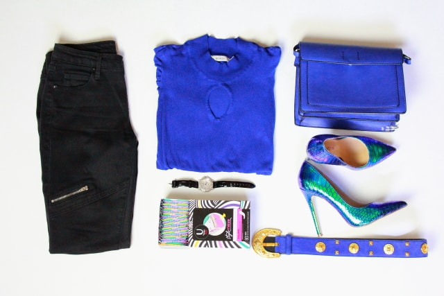 Foam roll used as a backdrop for outfit flat lay