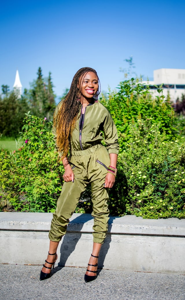 bomber jumpsuitOlive Bomber Jumpsuit   Fashion blogger rocking a one-piece, long-sleeve jumpsuit paired with a multi strap sandals for a chic street style outfit. Click to check out more of her fun and affordable style.