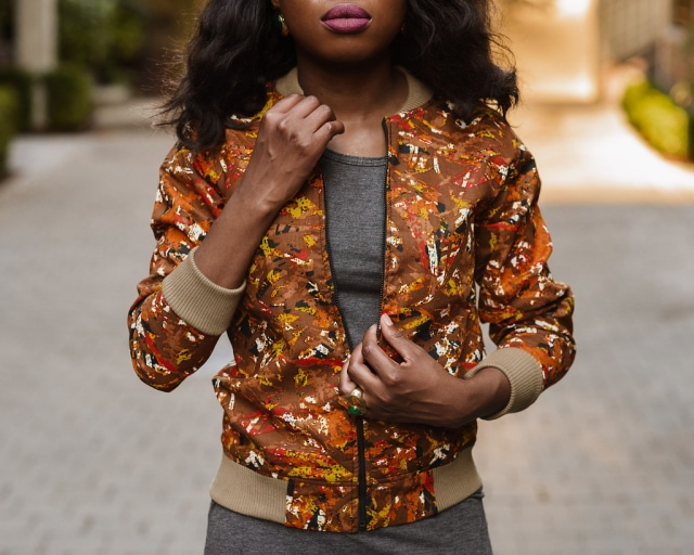 African Print Ankara Bomber Jacket   Fashion blogger styling a chic Ankara bomber jacket with a simple midi-length bodycon dress completed with black multi-strap sandals.