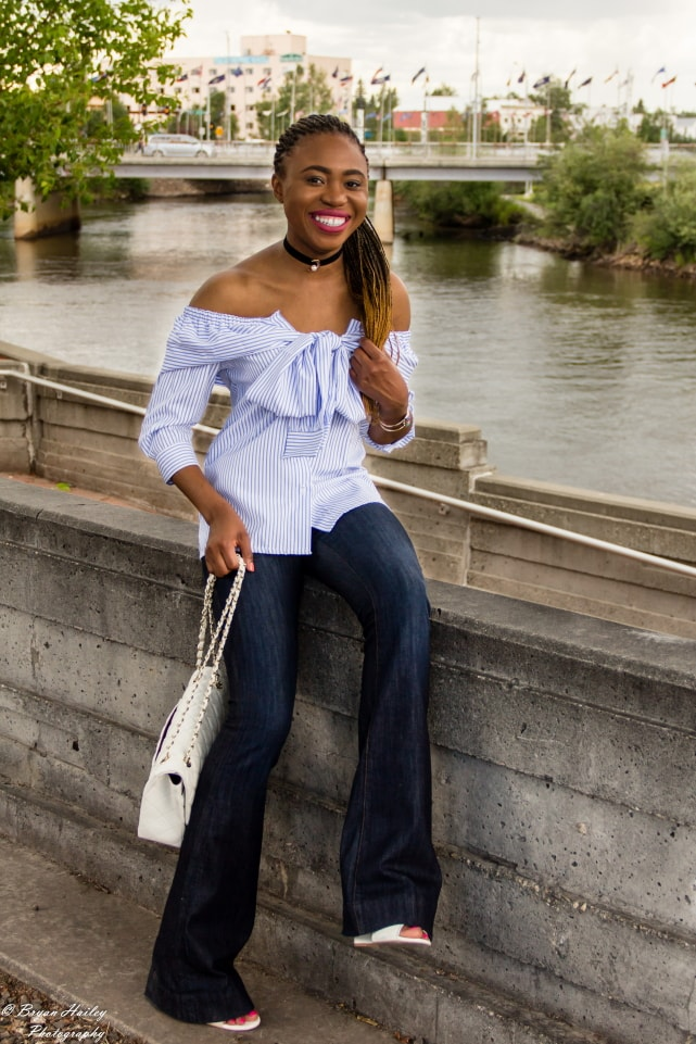 A super cute summer outfit wearing a wide leg flare jeans and a stylish off the shoulder faux sleeve top. Visit the blog for the complete look.