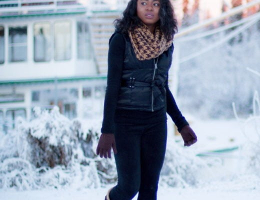 Winter fashion outfit idea wearing a sleeveless winter vest, waterproof insulated winter boots, and Cuddl Duds fleecewear pants, and infinity scarf