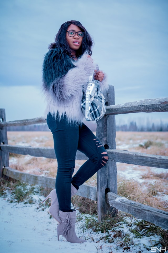 Faux fur jacket outfit | A trendy fall street style combining ombre faux fur coat, ripped black jeans, fringe ankle booties. Fashion blogger | Alaska | Black blogger | Fall fashion | Ripped denim