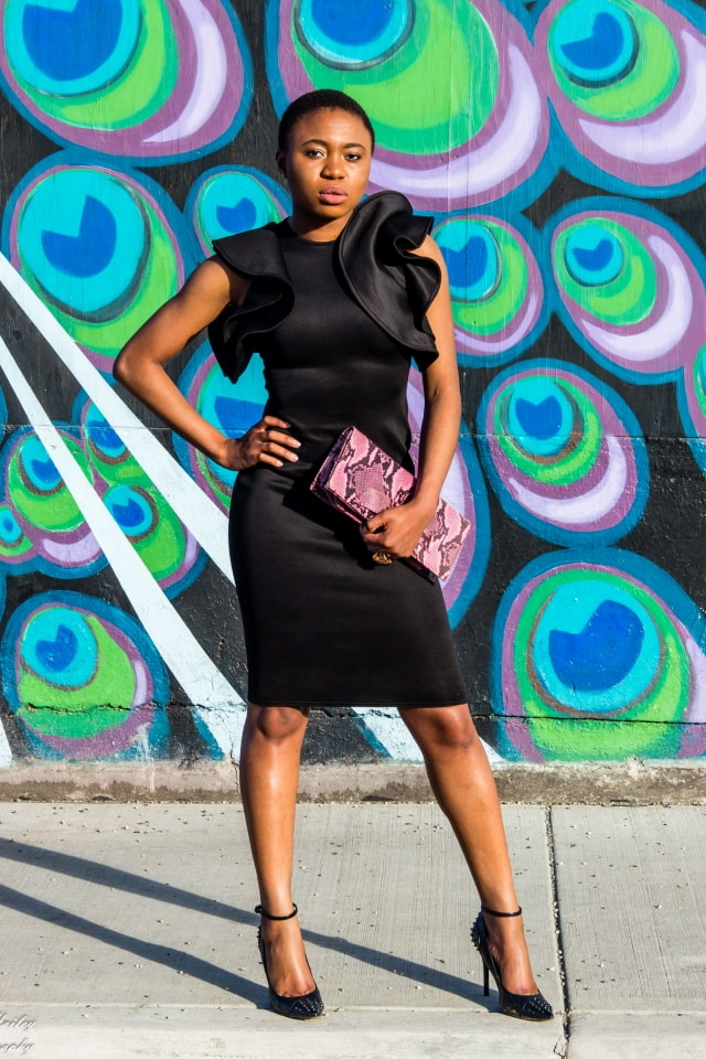 OMG! Love this black midi dress with ruffle sleeves. It'll be a perfect wedding guest look or a dressed up occasion. Love how she kept the look simple in this black monochrome look and a touch of pink. The statement sleeves, animal print purse, and studded heels make the look pop. | Summer fashion | Fashion blogger | Spring style | Spring outfit | Bodycon dress outfit | Spring fashion | Summer looks | Summer hair | Street Style | Modest fashion | Conservative style |