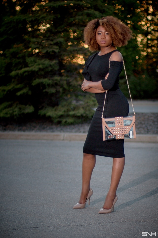 OMG her black midi dress is giving me life! 🔥 Can't get over the asymmetric sleeves with ruffles and cold shoulder pizzazz. She nailed this dress outfit by pairing it with classic nude pumps and an envelope clutch. A dress that you can dress up or down! Little black dress, bodycon dress, Dress with ruffles, Black dress, LBD, Summer dress, Formal dress, Modest dress, Wedding guest outfit, Black girl, Classy dress, womens style