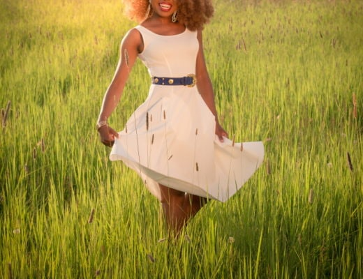 Can't get over her stunning white summer dress! 💃 Twirling in the prairie fields. Her sleeveless A-line midi dress has the perfect flare. Bold statement hoop earrings and embellished blue belt perfects her outfit. A dress that you can dress up or down! Little white dress, flare dress, Dress with flare, White dress, Summer dress, Formal dress, Modest dress, Wedding guest outfit, Black girl, Classy dress, womens style