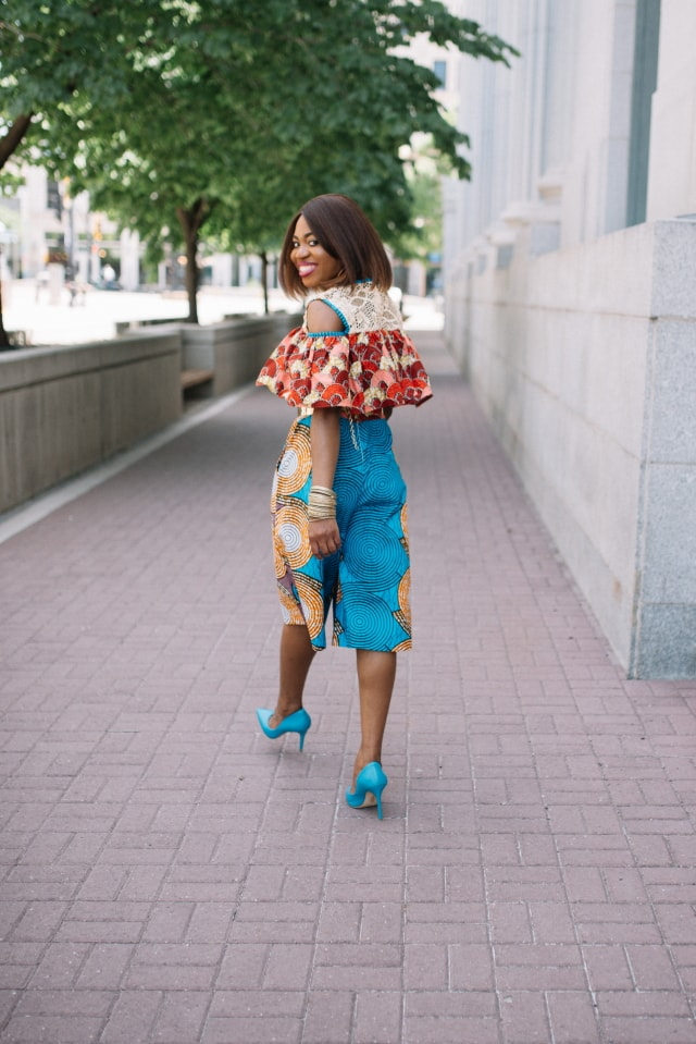 Such a stunningly irresistible African print romper! I wouldn't be surprised if she stopped traffic wearing this elegant mixed print ankara African style. The cold shoulder, lace detail and matching blue heels definitely make this outfit a hit! Adding to my wishlist as a gift idea today. Fall style, dutch wax, kente, kitenge, dashiki, African styles, African prints, Nigerian style, senegal fashion #ankara #africanprint #kente #ootd #romper