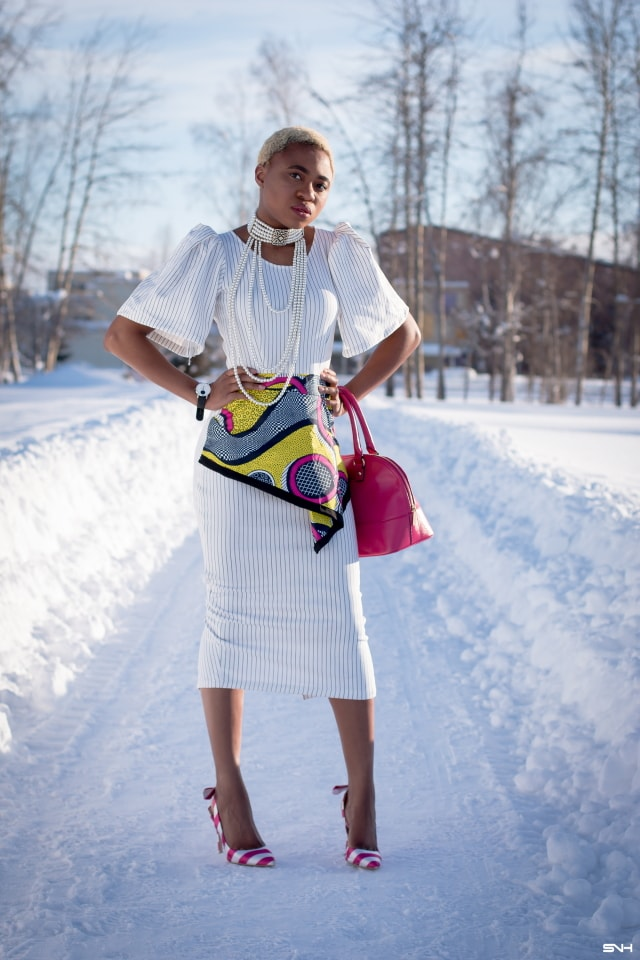Oh yes! This African print peplum dress is making me feel all sorts of excited about modern African dress styles. That asymmetrical peplum and exaggerated sleeves scream bold, classy and stylish. And that vibrant slingback pumps, choker necklace and dome satchel? I'm excited to see more stunning ankara styles like this! #africanprint #ankarafashion #ankara #kente #wakanda