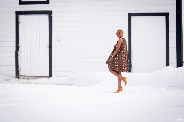Fashion blogger, Louisa takes us on a month-long series rocking the prettiest African print styles. This ankara flared dress as me oohing and ahhing. The perfect dress for a balmy summer dress. The free-flowing form makes the African print dress a breathable and comfortable option. Love how she makes winter look so warm! #ankara #africanprint #ankarafashion Kitenge, Dashiki, African print dress, African fashion, African women dresses, African prints, Nigerian styleNigerian fashion