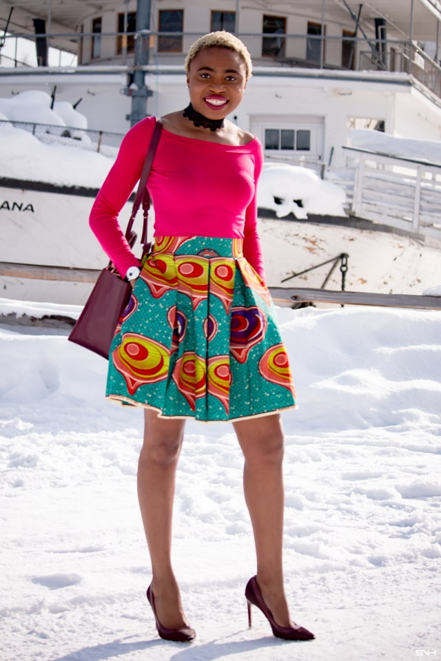 Day 22: Preppy Ankara Printed Skirt | Everyday style for the fashionable woman. Nigerian style blogger takes us on an epic ride wearing the most enviable African print clothes for 30 days. Check out how she paired this signature preppy ankara printed skirt with a modern touch of a boat neck / off the shoulder top. The burgundy bucket purse and matching heels seals this look to perfection! #africanprint #ankara #fashionblogger