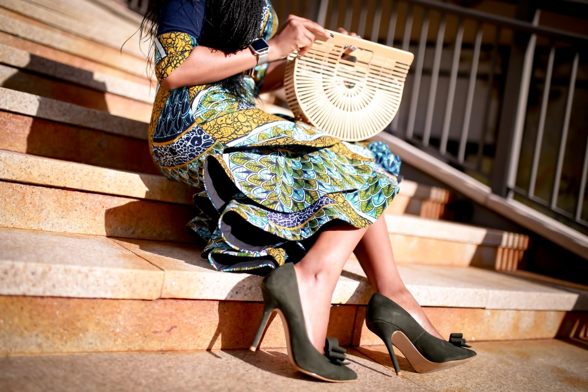 An African midi dress can be dressed up or down for special occasions. Here are two easy ways to style this ankara dress plus how to get a custom piece or make one for yourself! All about African clothing, how to wear, African attire, African fashion dresses #ankarafashion #africanfashion #africanprint #nigerianfashion #womensafricanfashion