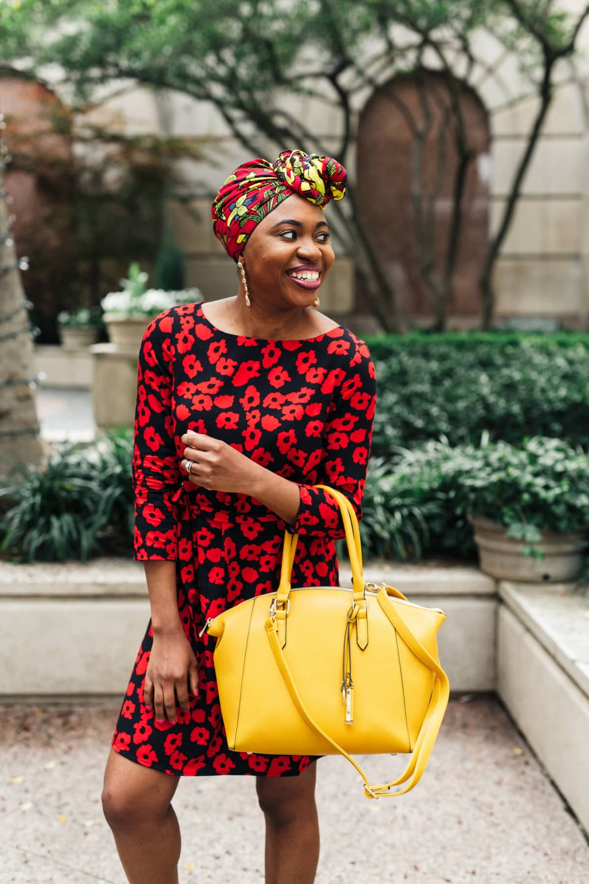 Celebrating the union between two cultures rocking an ankara head wrap with a floral dress perfect for spring and summer fashion. And sharing the best places to score the most stylish African print scarves for women. #africanfashion #floraldress #ankarastyles #turban