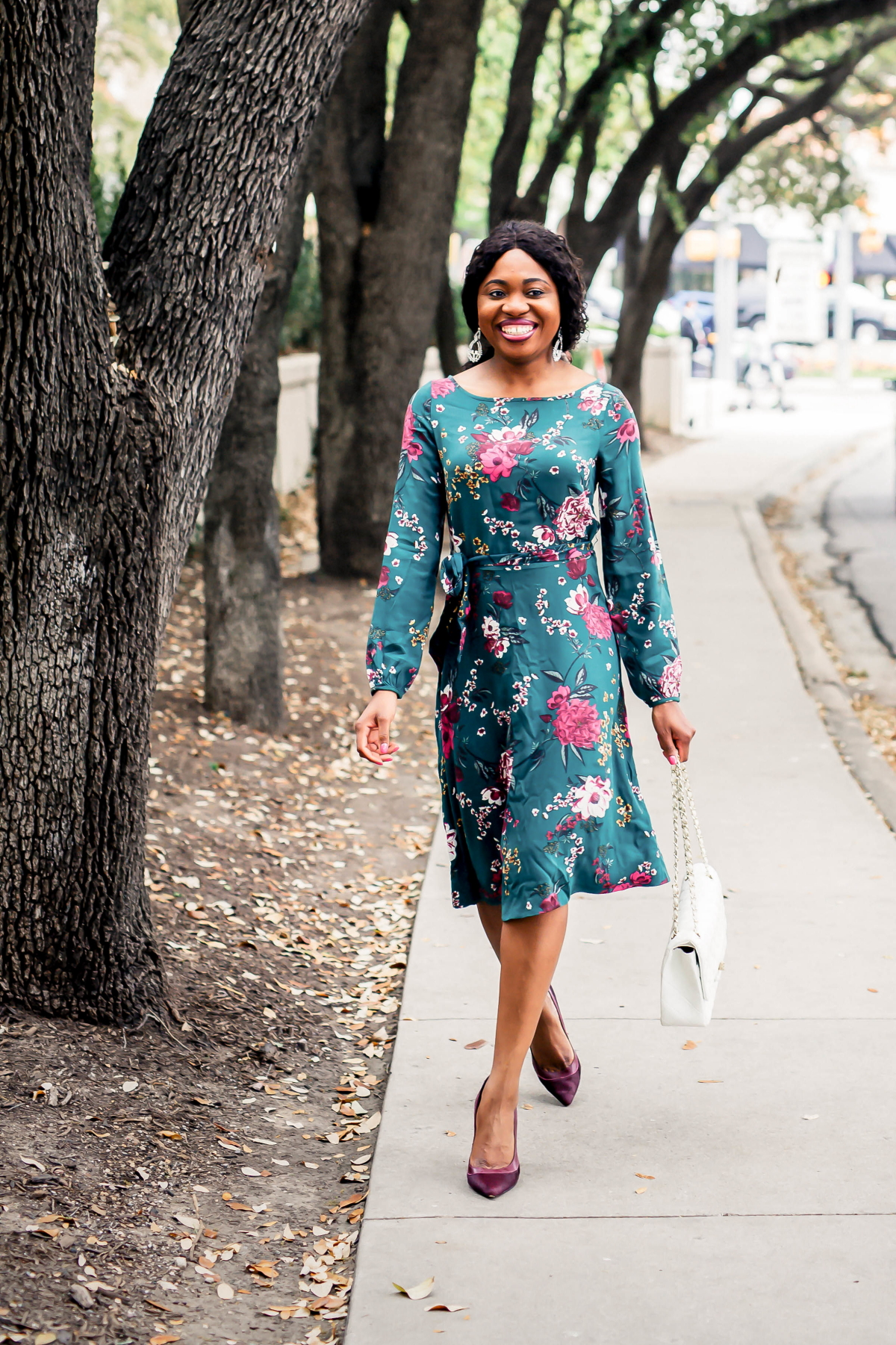 This knee-length a-line dress is seriously the best floral blouson sleeve dress for summer. A nice but not overpowering contrast of colors makes this dress perfect for weddings, cocktails, work, and red carpet events. Your wallet will thank you too. #summerfashiontrends #weddingguest