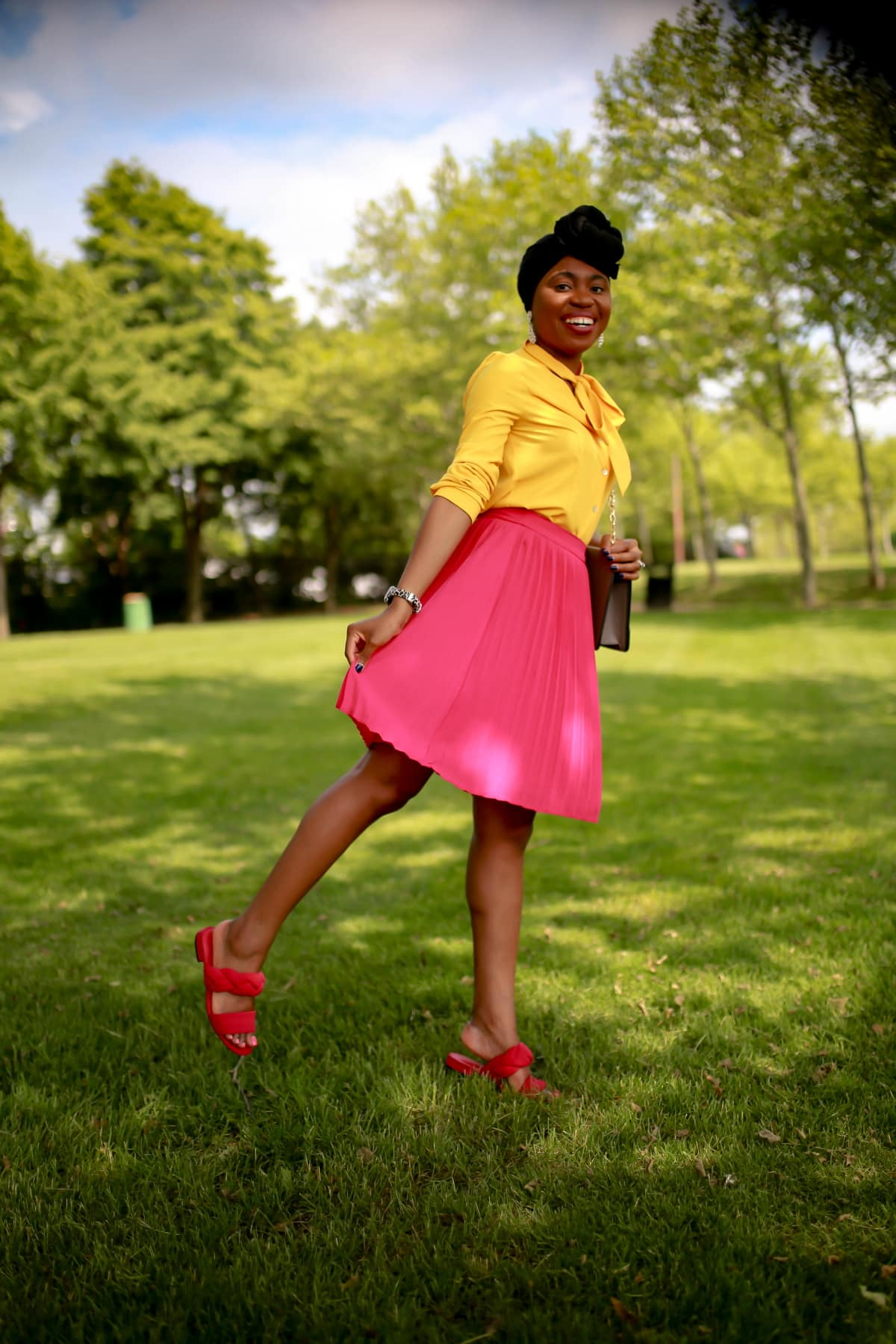 mustard top outfit | Pleated Midi Skirt, pink braided slides, black turban outfit