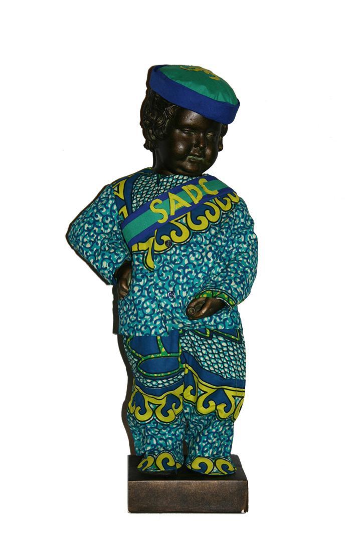 Le Petit Julien in African print clothes