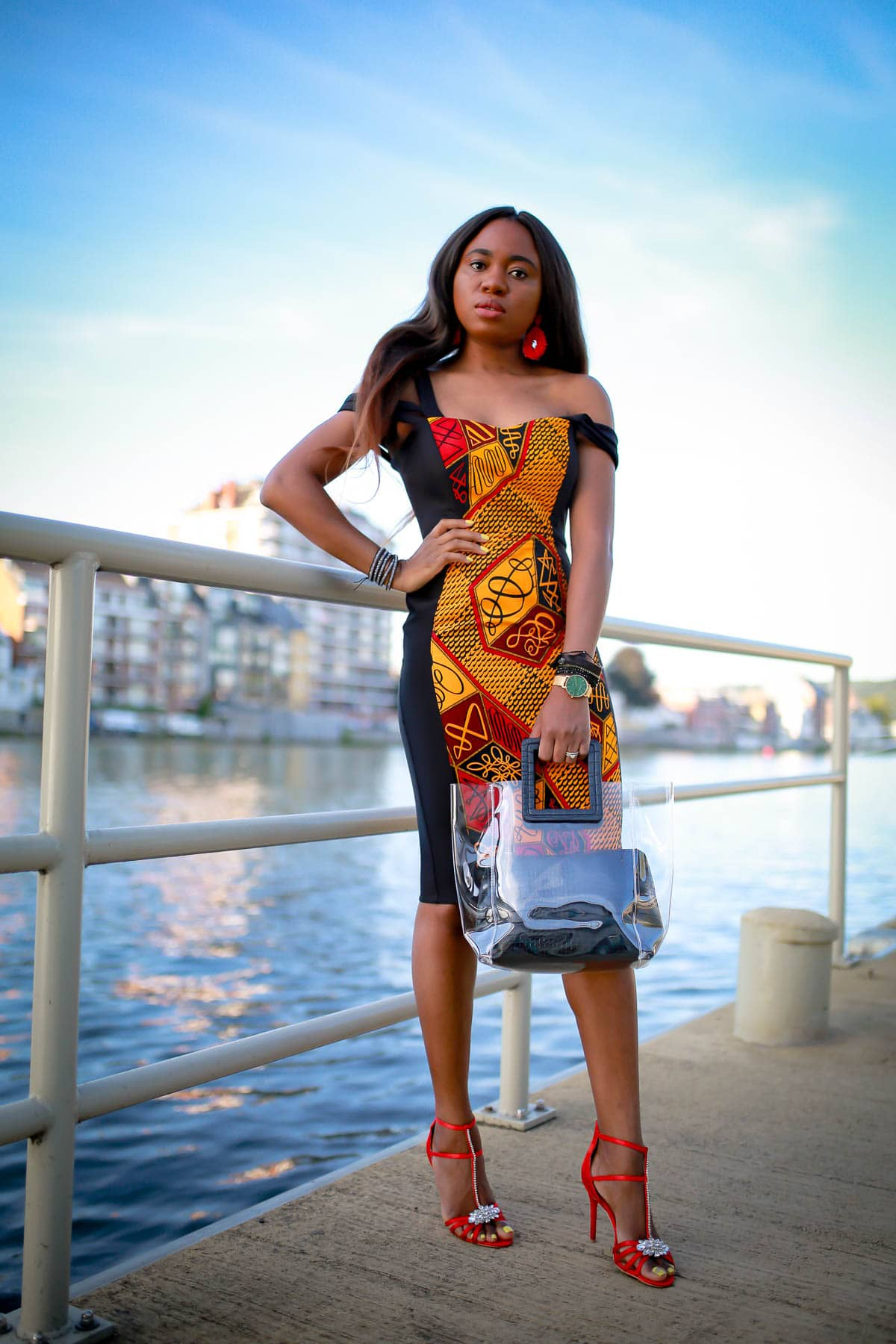 #africanfashion Totally crushing on this African print sheath dress that is perfect for special events like weddings, birthday parties and more. African fashion lover, Louisa, shares this stunning ankara dress and where to find a similar style. #africanfashionoutfits