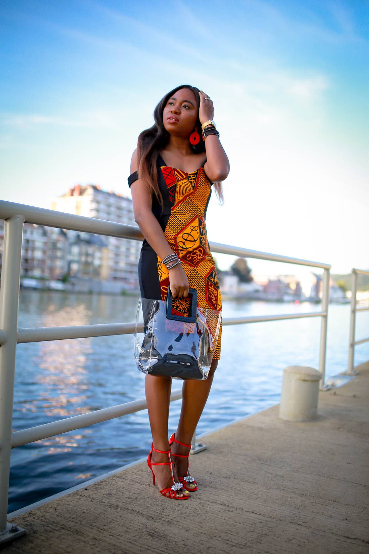 #africanfashionoutfits Totally crushing on this African print sheath dress that is perfect for special events like weddings, birthday parties and more. African fashion lover, Louisa, shares this stunning ankara dress and where to find a similar style. #africanwedding #ankarastyles