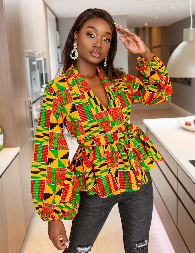 An epic roundup of the best African print ankara tops to try this year. Everything from peplum and wrap tops to crop tops and hi-low tops. Plus details on where to get this stunning African clothing for less.