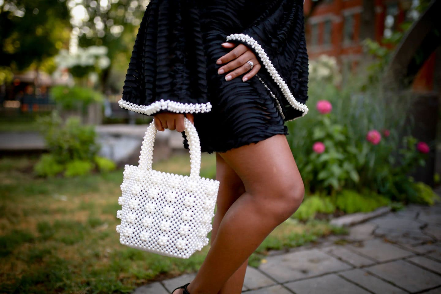 Designer-inspired pearl tote paired with a sweet and sassy little black dress for women perfect for cocktails, holiday parties, weddings, and other special events.