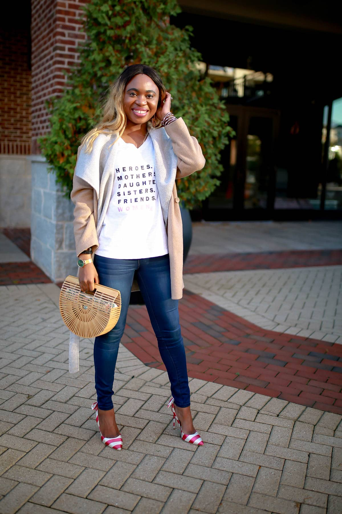 The easiest way to dress up your t-shirt and jeans outfit is to pair with a fitted tee, skinny jeans without excess embellishments, and a pair of ballet flats or slides. Throw on a clean black or denim blazer and be ready to conquer the world.