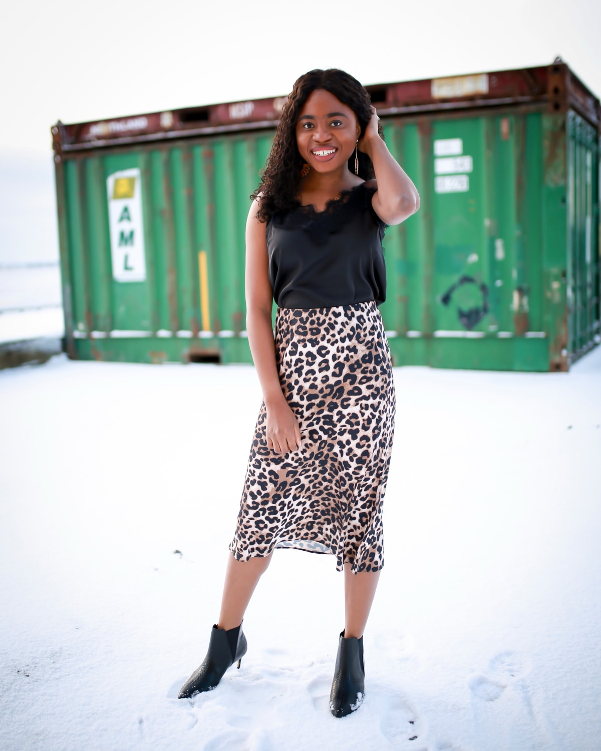 Crushing on this stylish leopard print outfit paired a chic lace-trimmed cami with a timeless animal print midi skirt and croco-embossed kitten heeled boots. Definitely, the perfect way to add a sensual touch to your outfit.