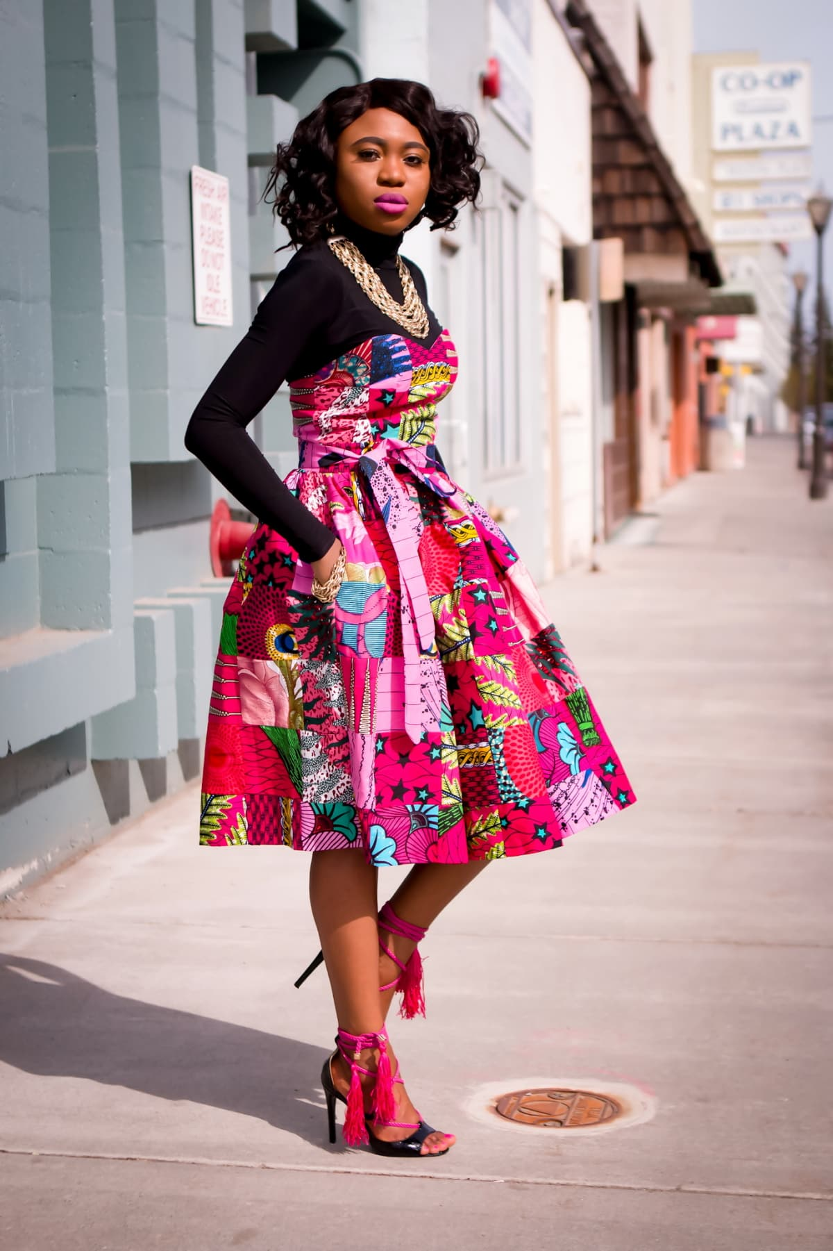 Looking for an African dress to wear to a special occasion? You'll love this midi dress styled by Louisa of La Passion Voutee. Get the scoop about this dress and details on where to get this stunning African attire.