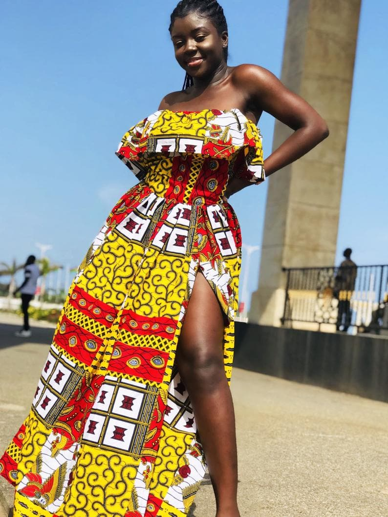 Presenting the playful vibrant yellow off shoulder African style dress