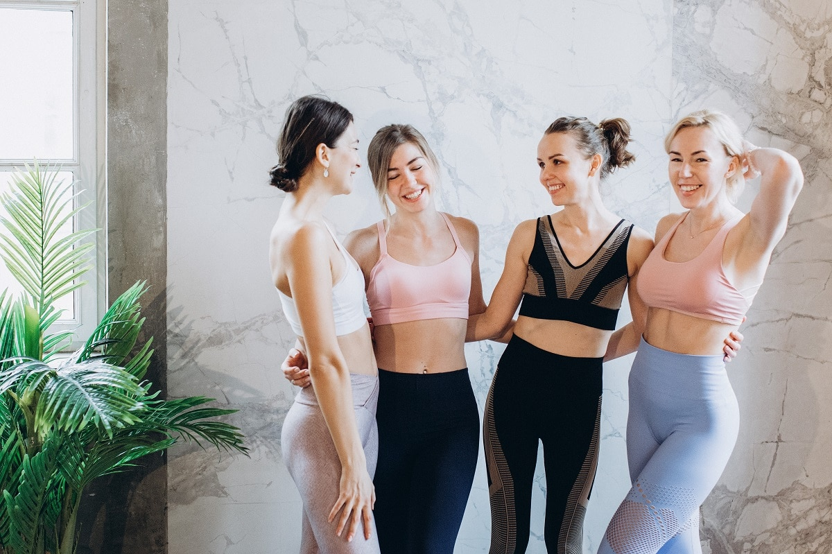 Fitness lovers having fun in their workout leggings