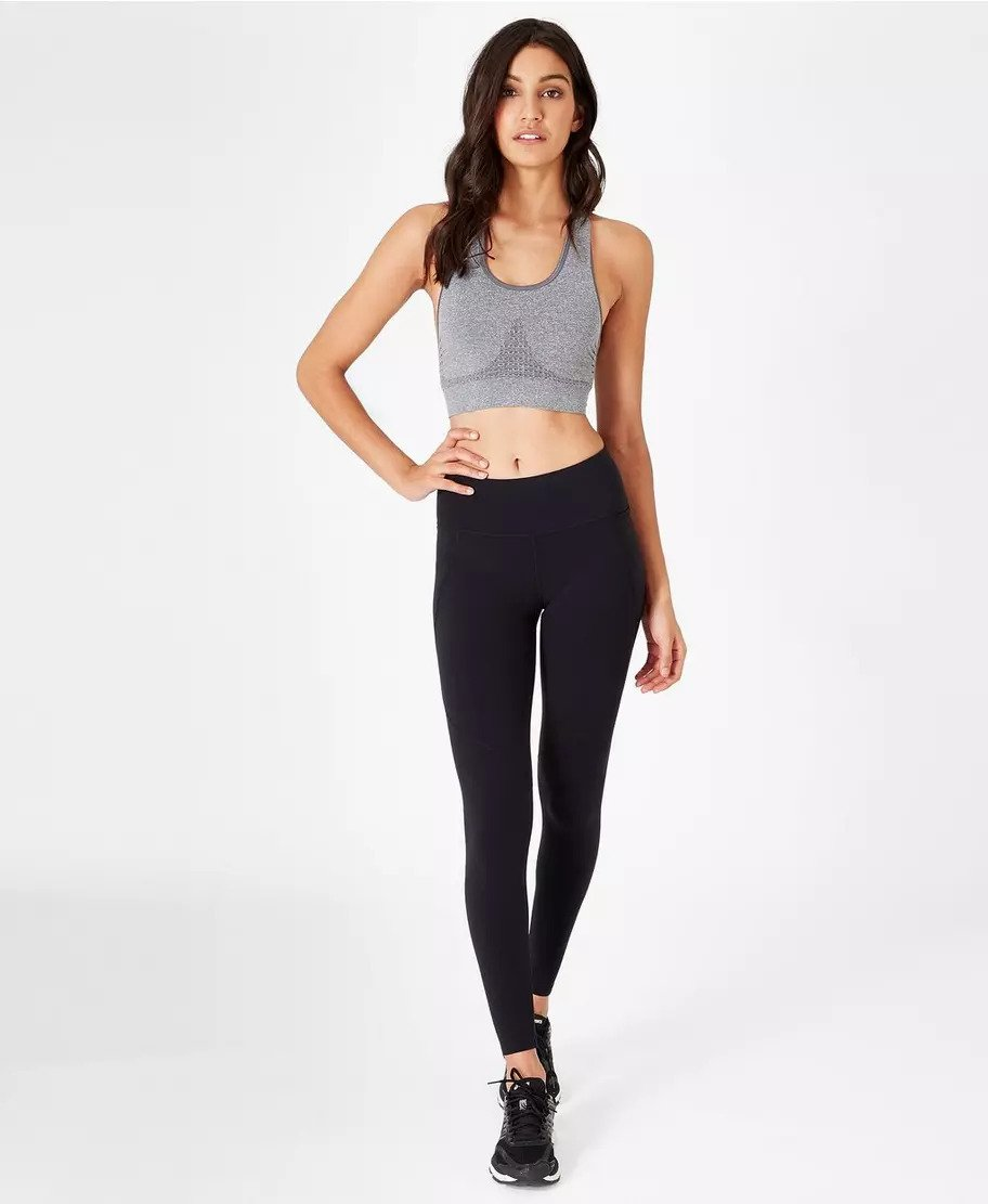 a model rocking sweaty betty bestselling leggings