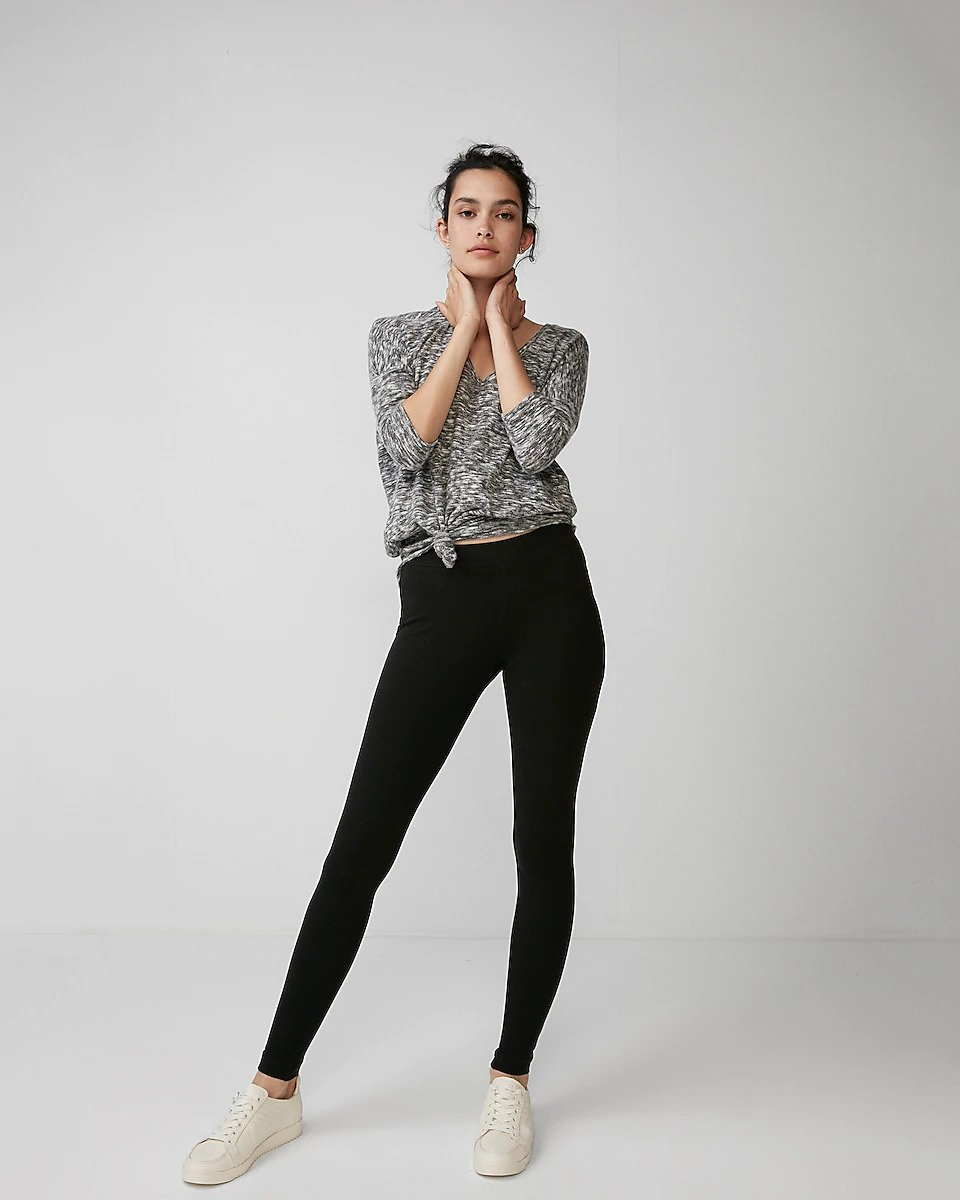 woman looking fabulous in Express leggings top seller