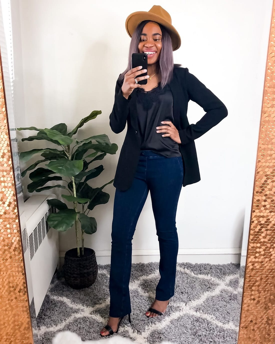 A chic camisole goes well with a Betabrand yoga jeans