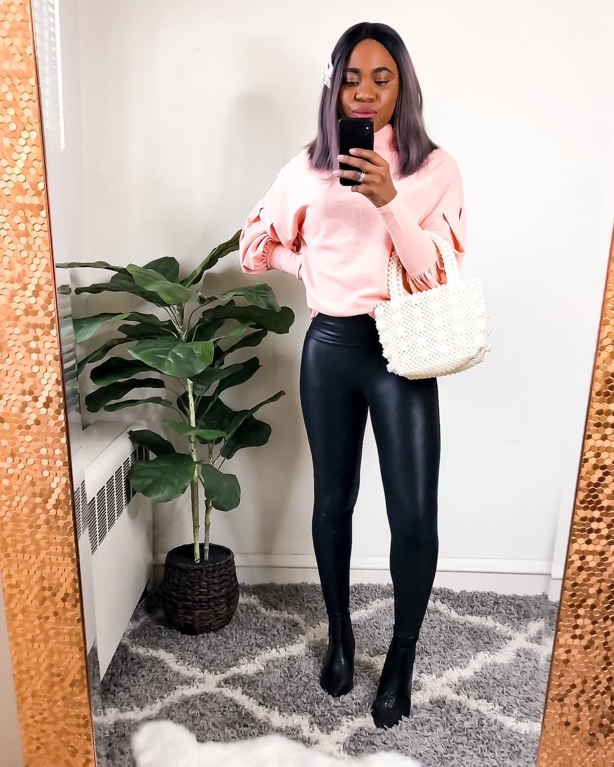 Knitwear and leather leggings outfit