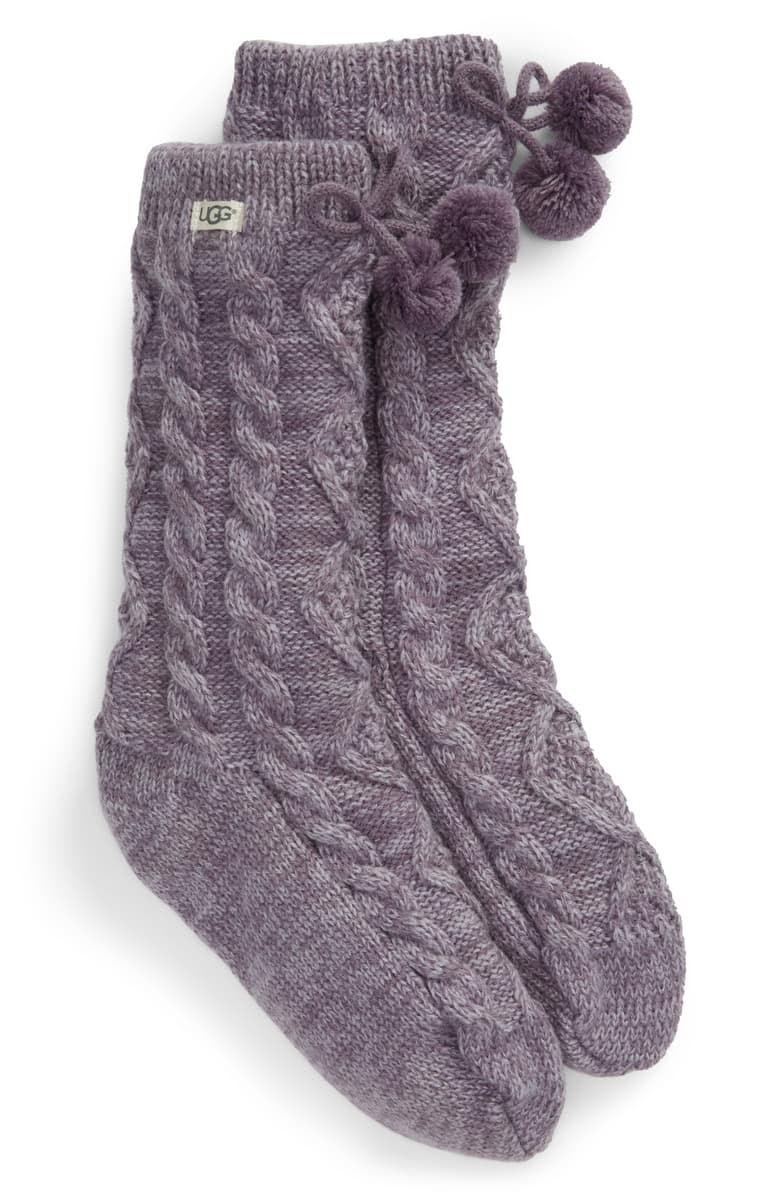 The UGG pompom socks will keep you warm and cozy