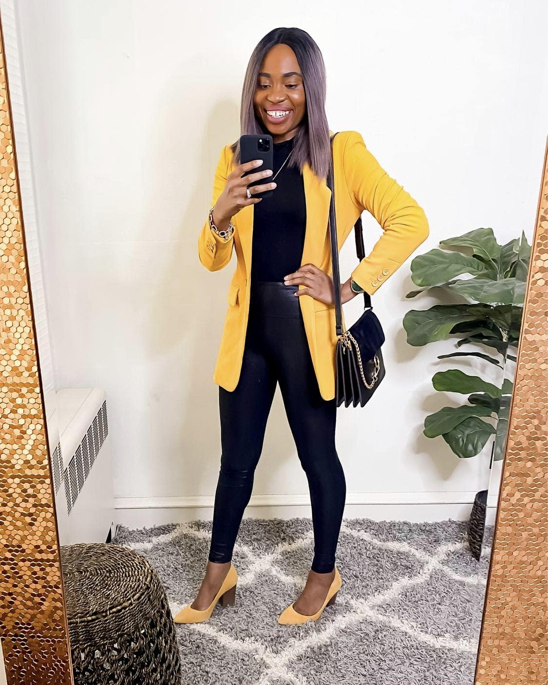 A formal one button yellow jacket paired with a pair of Spanx
